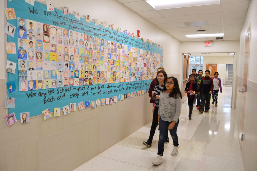 Students Walking Along James Monroe School Song Bulletin